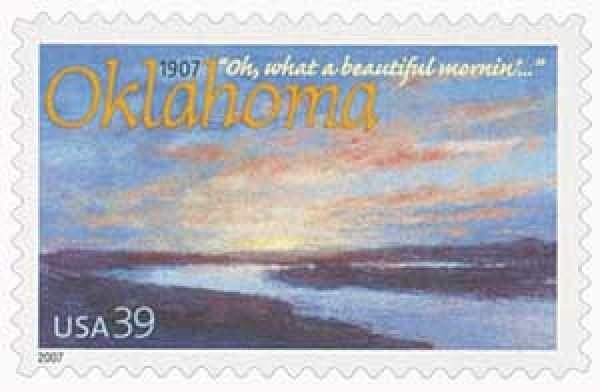 U.S. #4121 – Oklahoma centennial stamp picturing sunrise on the Cimarron River and a line from the musical, Oklahoma.