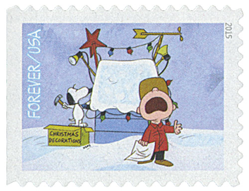 2015 First-Class Forever Stamp - A Charlie Brown Christmas: Charlie Brown with Snoopy Decorating his Doghouse