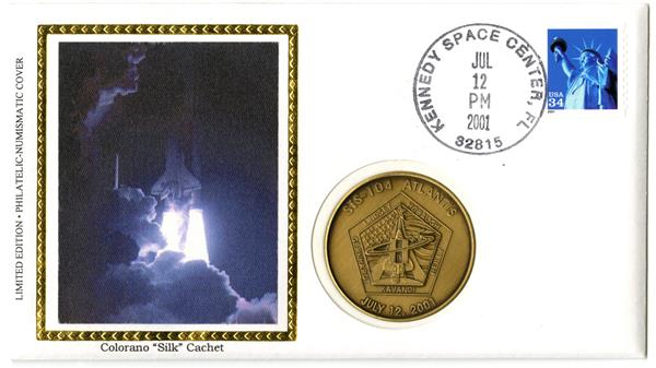 STS-104. Launch cover with official medal